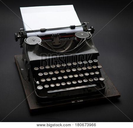 Antique Typewriter. Vintage Typewriter Machine on black.