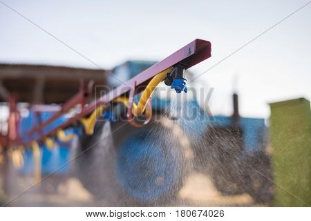 The Tractor Sprinkles The Pesticides