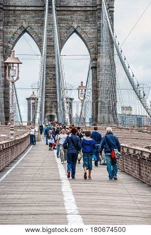NEW YORK-AUGUST 24 - People enjoy a walk across the Brooklyn Bridge on August 24 2010 in New York City