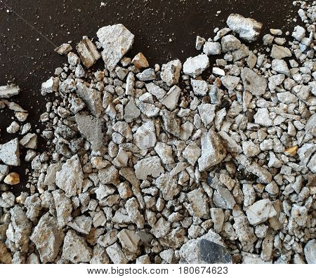 scrap stone and scap cement on dirty ground