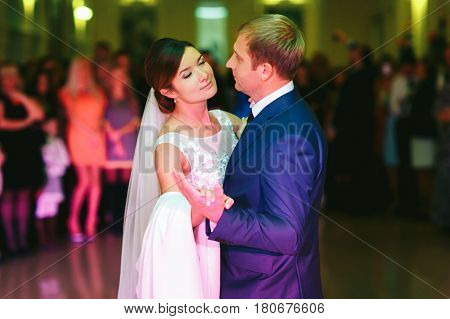 Bride Closes Her Eyes While Dancing With A Groom
