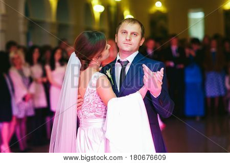 Blu-eyed Groom Looks Up While Dancing With A Bride