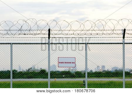 security restricted area with a barbed wire fence