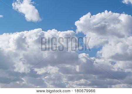 Beautiful Cumulus Clouds In The Clear Blue Sky.