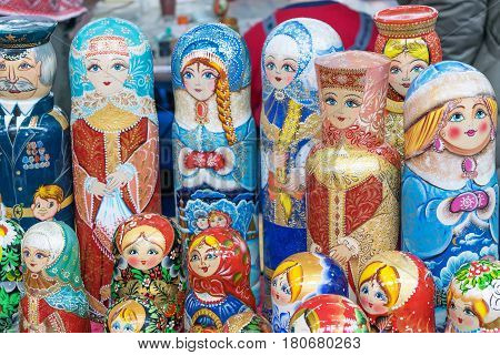 A few figures dolls. Colorful figures of different shapes made of wood. Figures of beautiful women and military men.