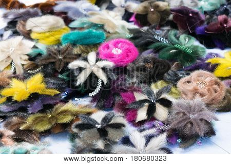 Several Of The Female Pins In The Form Of Fur Flowers.