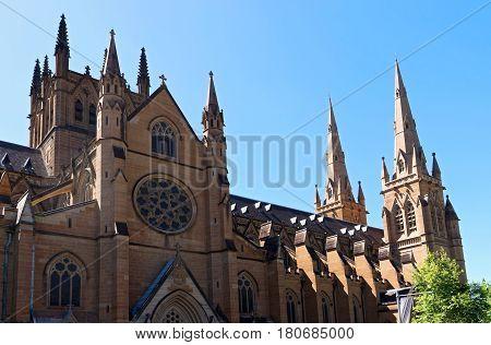historic cathedral of gothic revival architectural style in central business district of sydney in new south wales australia
