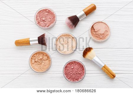 Makeup Powder With Brushes On Wood Background