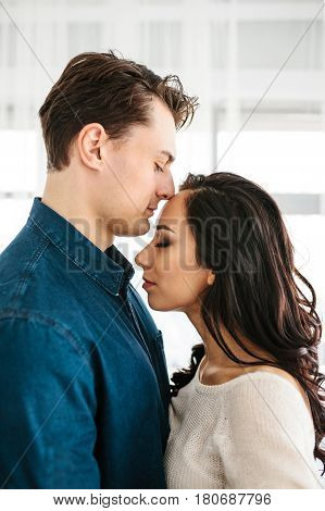 Beautiful young woman with a man. Care reliability love and close relationships between people.