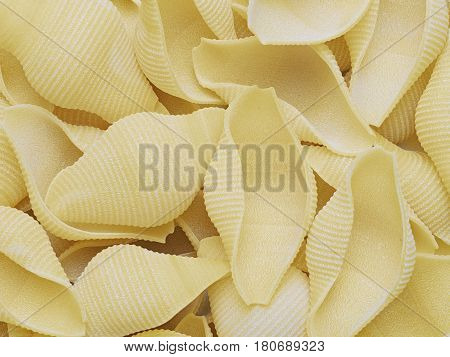 close up of raw uncooked conchiglie jumbo shell pasta food background