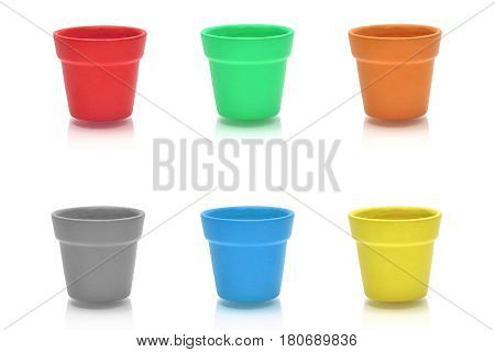 Colourful ceramic pot collection on white background