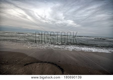 Sunset At The Sea Shore Of A Beach With Rocks And Stormy Waves, Beautiful Seascape At Caspian Sea Ab