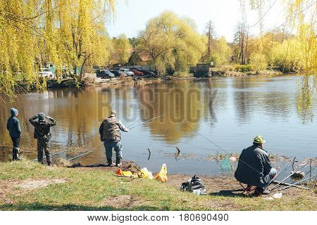 UKRAINE, KYIV - MARCH 10, 2017: The fishermen on the lake catching fish in the spring