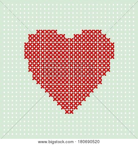 Red heart embroider by thread on turquoise background. Cross stitching on canvas