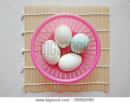 Duck eggs in a basket put on bamboo basketry