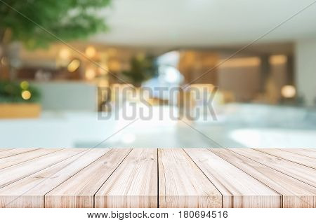 Empty Wooden Table Top With Blurred Modern Lobby Background.