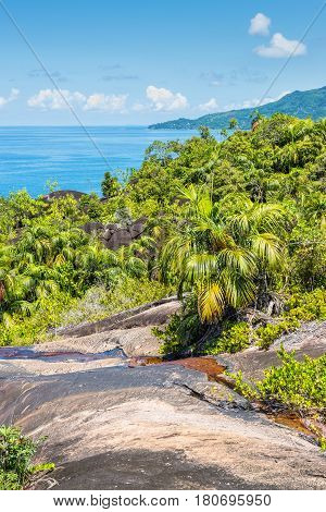 View from Anse Major Nature Trail over the northwest coastline of Mahe island and granite rock in the foreground Seychelles Indian Ocean Eastern Africa