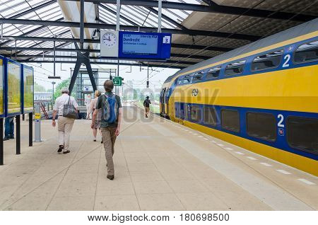 ROTTERDAM, THE NETHERLANDS - APRIL 16: Unknown travellers are entering and leaving an intercity train at the central station of Rotterdam on April 16, 2014 in the city of Rotterdam, the Netherlands