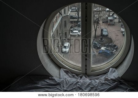 Urban view from the round window in  Saint-Petersburg