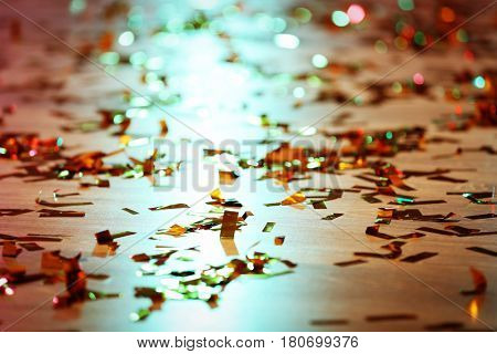 Floor in night club covered with confetti
