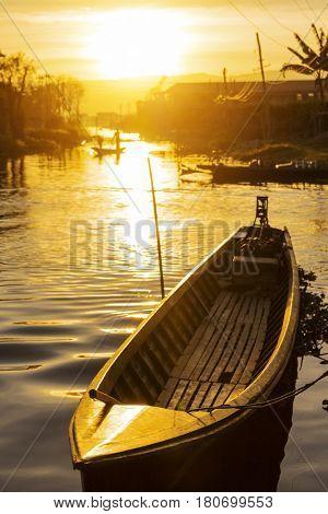 Traditional floating village at Inle Lake Sunset , Myanmar ( Burma )