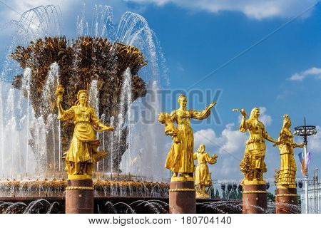 MOSCOW - JULY 29, 2016: The Peoples Friendship Fountain in Exhibition of Achievements of National Economy (VDNKh). It was built in the 50s. 16 golden sculptures represent republics of the Soviet Union