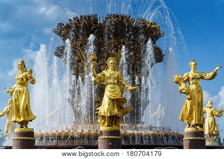 MOSCOW - JULY 29, 2016: The Peoples Friendship Fountain in All-Russia Exhibition Centre (VDNKh) in Moscow, Russia. It was built in the 50s. 16 golden sculptures represent republics of the Soviet Union.
