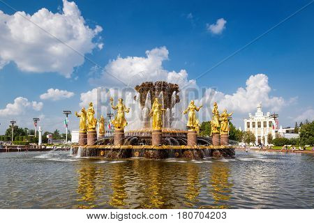 MOSCOW - JULY 29, 2016: The Peoples Friendship Fountain in Exhibition of Achievements of National Economy (VDNKh). It was built in the 50s. 16 golden sculptures represent republics of the Soviet Union.