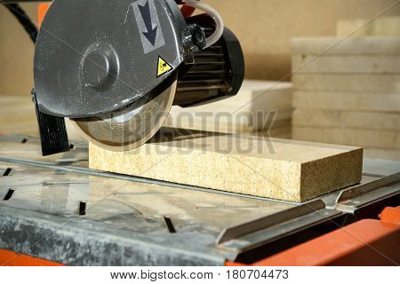 Circular saw with sawed-off tile. Equipment for the repair of apartments.