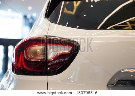 The rear light of a modern car with stop lights and reversing lights