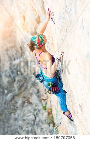 Climber While Inserting Rope Carabiner