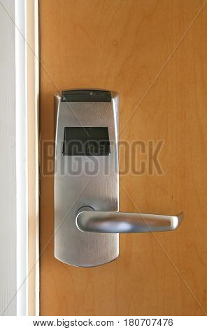 Keycard electronic lock on wooden door