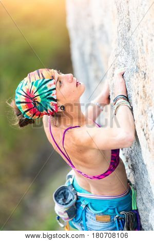 Girl Climber Climbing While Studying The Way