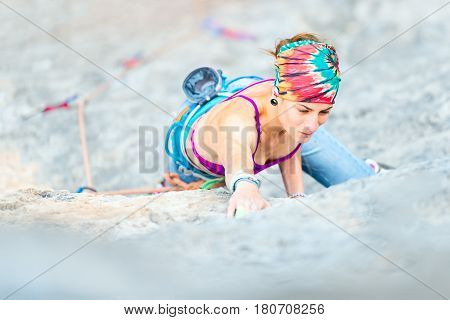 Girl practicing free climbing in summer time