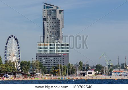 GDYNIA, POMERANIAN / POLAND - AUGUST, 2016: City residents and tourists lounging on a beach city