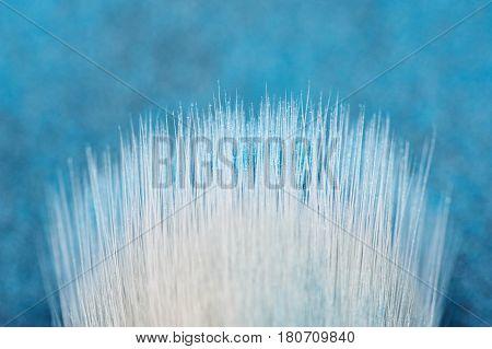 Make-up Artist's white Brush Bristles on blured blue Background
