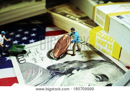 Man Moving Penny With Stacks Of Money High Quality