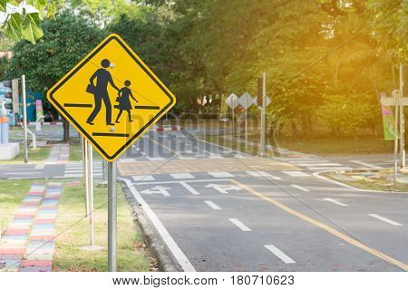 Students crossing ahead sign. bicycle , sign
