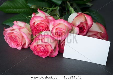 Bouquet of pink roses and empty tag with copy space. Closeup view. Mothers day, Women's day or other holidays gift mockup