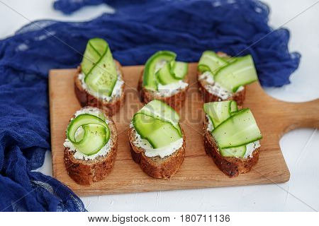 Sandwiches with cheese feta and cucumber. The concept of food and vegetarianism.