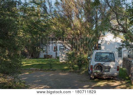 NIEU BETHESDA SOUTH AFRICA - MARCH 22 2017: Early morning at the camping sites behind the backpackers building in Nieu-Bethesda an historic village in the Eastern Cape Province