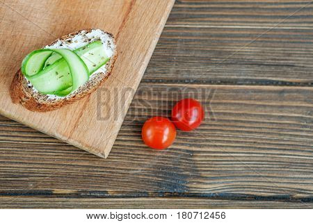 Canape with cucumber and feta cheese and cherry tomatoes. Top view. The concept of food and vegetarianism.