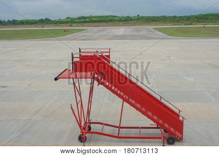 Movable boarding ramp for passenger is waiting for airplane.