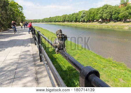 Uzhgorod Ukraine - April 27 2016: Small bronze statue of Good Soldier Svejk attached to the handrails at Kyivska embankment of the river Uzh