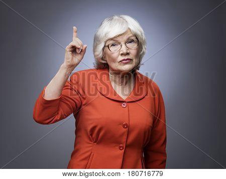 Senior Lady Points Finger Up