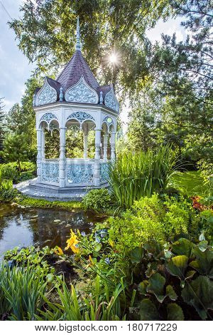 beautiful summer garden with alcove on day