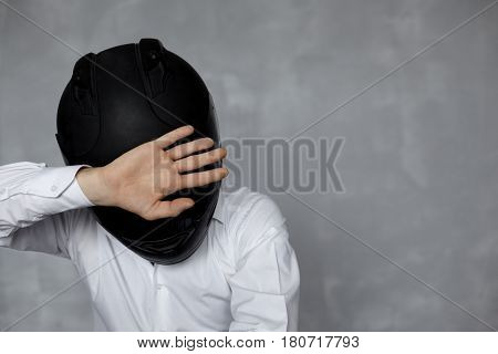Nagetion concept. Man in black helmet and white official shirt show no on body language. Copy space for motorcycle product or promotion text. Negative assessment in motor theme.