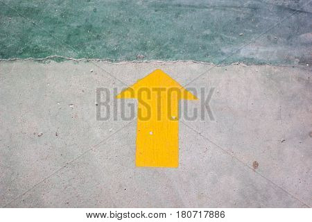Yellow Arrow Sticker On The Floor With Copy Space