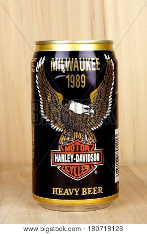 RIVER FALLS,WISCONSIN-APRIL 06,2017: A vintage can of Heavy Beer with a wood background.