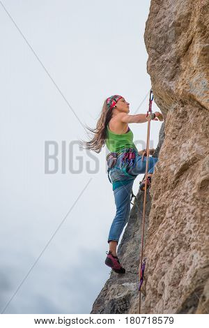 Young Woman During A Rock Climbing Adventure